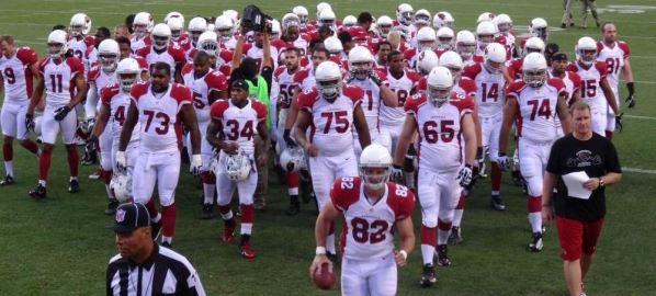 The Arizona Cardinals NFL football team leaving the field.