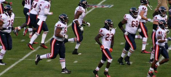 The Chicago Bears taking the field during game.