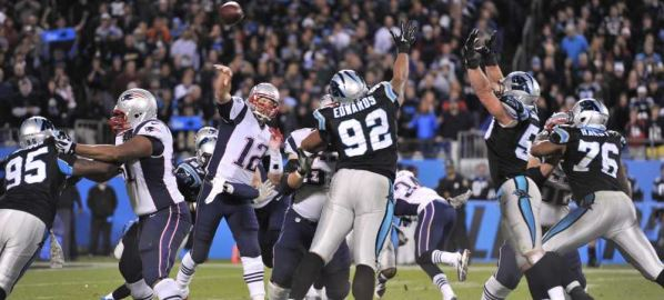Tom Brady attempts a pass against the Carolina Panthers.