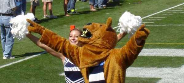 The Nittany Lion and a Penn State cheerleader at a football game versus Cincinnati.