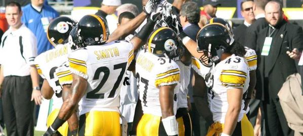 The Pittsburgh Steelers in a huddle during game.