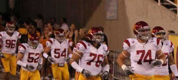 Southern California Trojans football players taking the field against Arizona State.