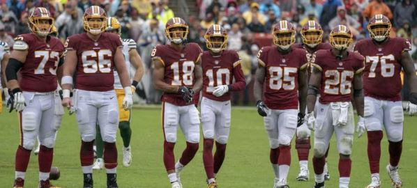 The Washington Redskins on the field during game against the Packers.